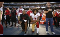 NFL teammates Eric Reid and Colin Kaepernick kneel next to former football player and Army Green Beret Nate Boyer, who suggested kneeling as a form of respectful protest